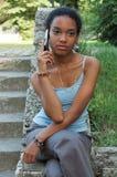 Muchacha en su teléfono celular Imagen de archivo