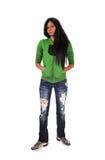 Muchacha en sudadera con capucha verde. Fotos de archivo libres de regalías