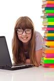 Muchacha en suelo con los libros y la computadora portátil Imágenes de archivo libres de regalías