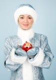 Muchacha en traje con el juguete del Año Nuevo Imagen de archivo