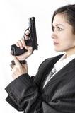 Muchacha en traje con la pistola Imágenes de archivo libres de regalías