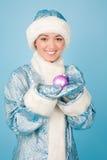 Muchacha en traje con los juguetes del Año Nuevo Imagen de archivo libre de regalías