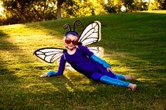Muchacha en traje de la mariposa Imagen de archivo