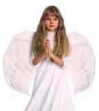 Muchacha en traje del ángel con el libro. Foto de archivo