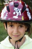 Muchacha en un casco imagenes de archivo