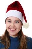 Muchacha en un casquillo Imagen de archivo libre de regalías