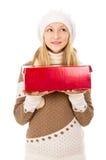Muchacha en un casquillo con un regalo Imágenes de archivo libres de regalías