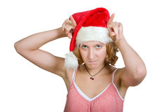 Muchacha en un casquillo de Papá Noel fotos de archivo libres de regalías