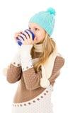 Muchacha en un casquillo del invierno Fotos de archivo