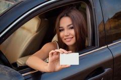 Muchacha en un coche Foto de archivo libre de regalías