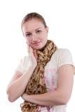 Muchacha en un fondo blanco en la bufanda Imagen de archivo