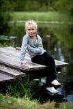 Muchacha en un puente Fotografía de archivo libre de regalías