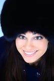 Muchacha en un sombrero de piel Foto de archivo libre de regalías