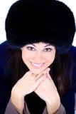 Muchacha en un sombrero de piel Fotografía de archivo