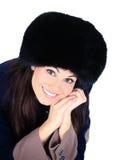 Muchacha en un sombrero de piel Foto de archivo