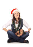 Muchacha en un sombrero de santa con la decoración de la Navidad Fotos de archivo libres de regalías