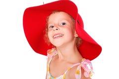 Muchacha en un sombrero rojo Foto de archivo libre de regalías