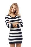Muchacha en un suéter rayado Imágenes de archivo libres de regalías