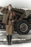 Muchacha en un uniforme militar soviético Foto de archivo libre de regalías