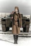 Muchacha en un uniforme militar soviético Imagenes de archivo