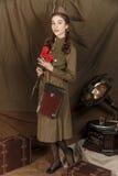 Muchacha en un uniforme militar soviético Fotografía de archivo libre de regalías