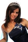 Muchacha en un vestido de noche azul y con una diadema Fotos de archivo