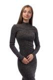 Muchacha en un vestido gris Imagen de archivo libre de regalías
