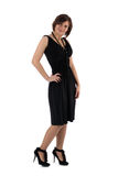 Muchacha en un vestido negro en un fondo blanco Fotos de archivo libres de regalías
