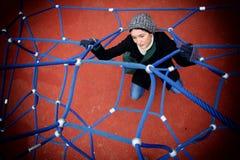 Muchacha en un web de araña Imagenes de archivo
