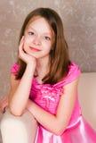 Muchacha en una alineada rosada Imagen de archivo libre de regalías