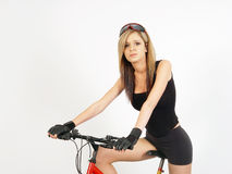Muchacha en una bici Fotos de archivo