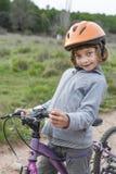 Muchacha en una bici Fotografía de archivo
