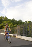 Muchacha en una bici Fotos de archivo libres de regalías