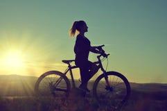 Muchacha en una bicicleta Imágenes de archivo libres de regalías