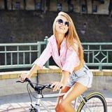 Muchacha en una bicicleta Fotos de archivo