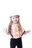 Muchacha en una blusa y pantalones de la tela escocesa del sombrero del verano con las ligas Imagenes de archivo
