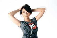 Muchacha en una camiseta cobarde Fotos de archivo libres de regalías
