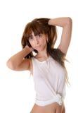 Muchacha en una camiseta mojada Imágenes de archivo libres de regalías