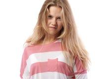 Muchacha en una camiseta rosada enojada Foto de archivo