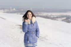Muchacha en una chaqueta azul Fotografía de archivo libre de regalías