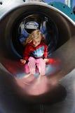 Muchacha en una diapositiva Fotos de archivo