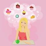 Muchacha en una dieta que sueña con la torta y dulces Foto de archivo