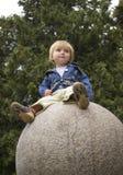 Muchacha en una esfera Fotografía de archivo