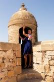 Muchacha en una fortaleza Fotos de archivo