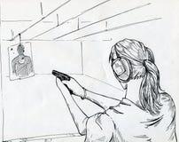 Muchacha en una galería de tiroteo Foto de archivo libre de regalías