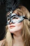 muchacha en una máscara fotos de archivo libres de regalías