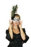 Muchacha en una máscara Imagen de archivo libre de regalías