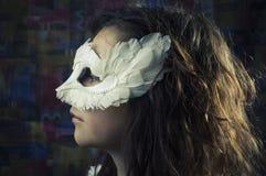 Muchacha en una máscara Foto de archivo libre de regalías
