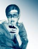 Muchacha en una máscara con un vidrio Imagenes de archivo