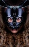 Muchacha en una máscara del conejo Imagen de archivo
